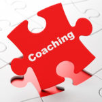 Education concept: Coaching on Red puzzle pieces background, 3d render
